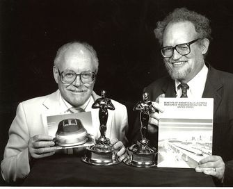 Dr. Gordon Danby (left) and Dr. James Powell (right)